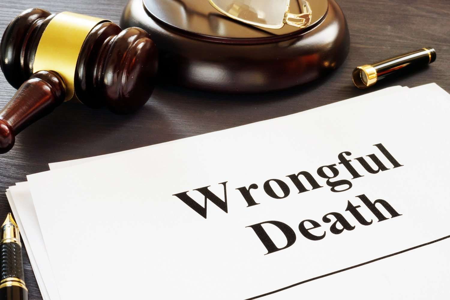 wrongful death lawsuit papers sitting on a desk with a gavel