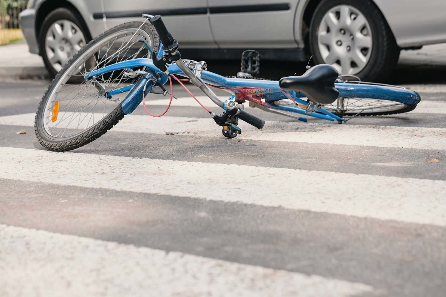 Bicycle laying on the road hit by a car