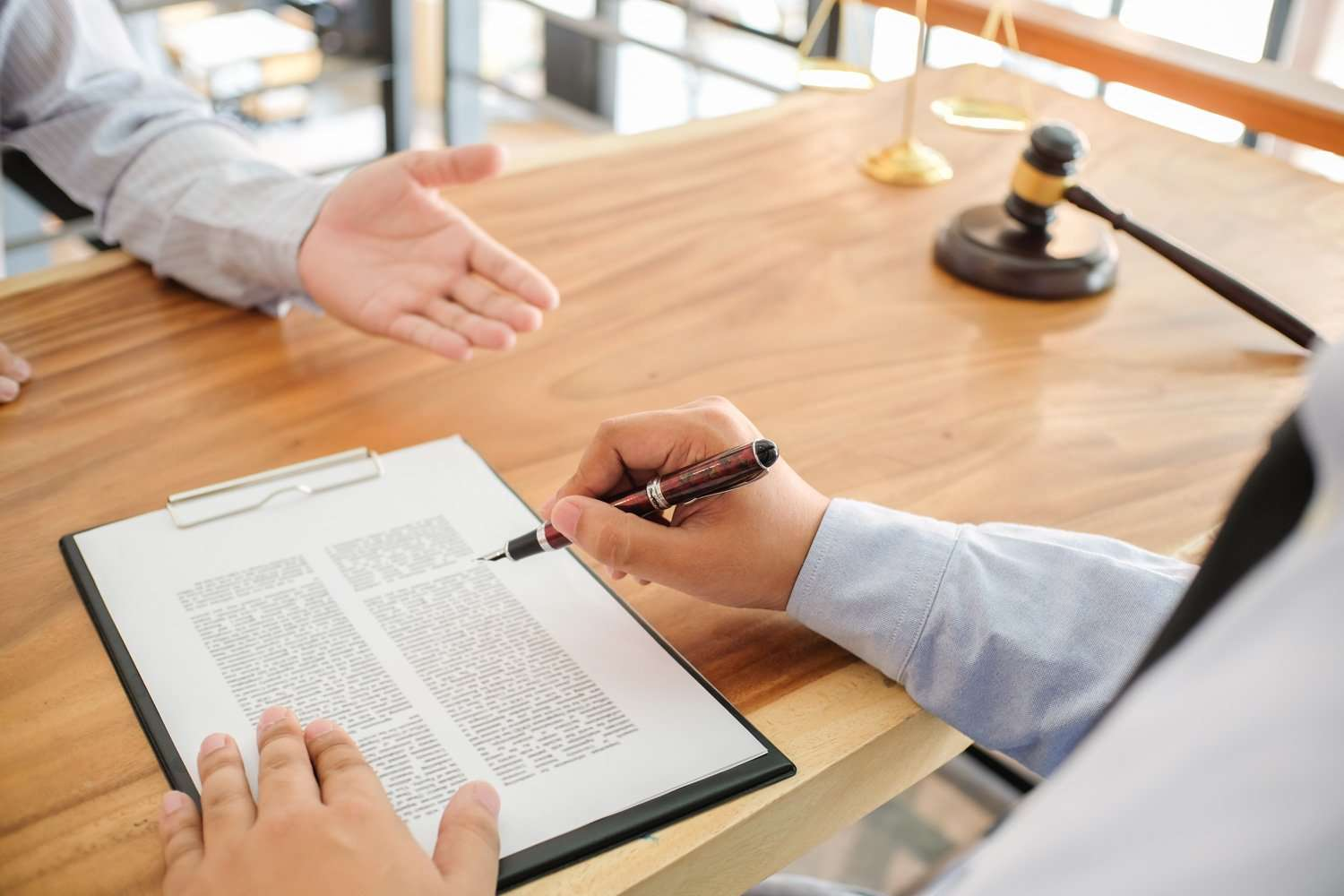 man signing real estate contract